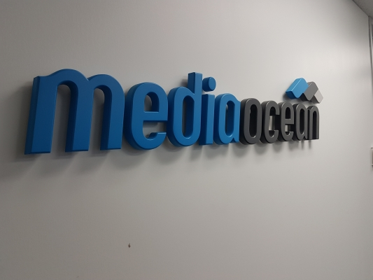 Cast aluminium 3D logo painted to match the colours MEDIAOCEAN