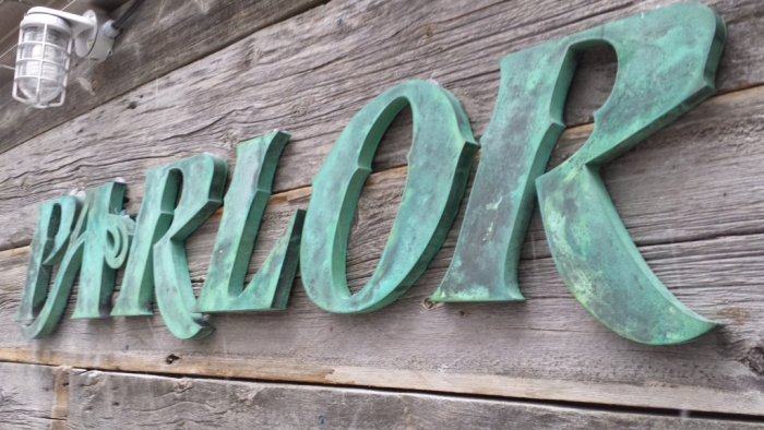 Custom bronze letters patina