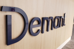 3D-cut-logo-raised-from-reception-desk-Demant