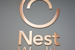 Brass custom 3D letters raised from the wall Nest