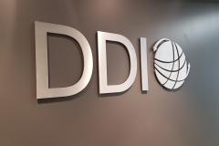 Brushed aluminium cut out logo DDI
