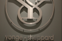 Raised cutout logo in brushed alumium metal