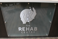 Brushed aluminium cut out letters Rehab-