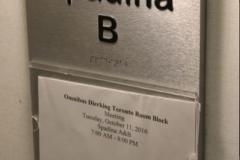 Custom brushed aluminium sign with raised text-