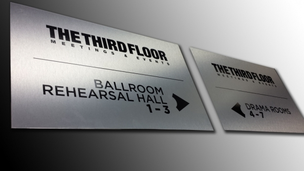 Brushed aluminium directional signs
