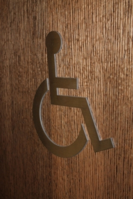 Raised stainless steel washroom sign