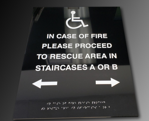 Raised-text-and-braille-handicap-sign