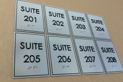 Custom suites brushed aluminium signs.