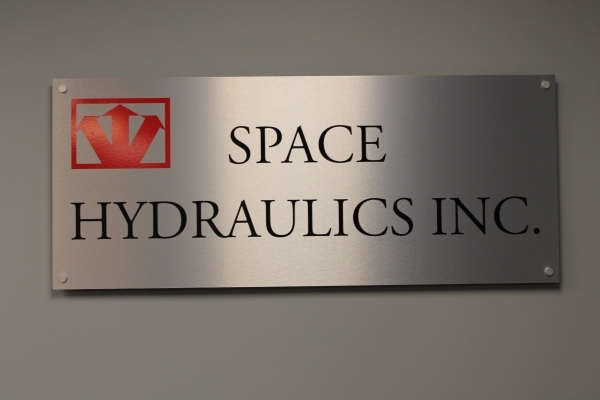 Brushed aluminium reception sign Space