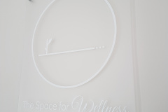 Frosted-acrylic-with-white-vinyl-graphics-reception-sign