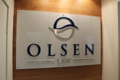 Lobby sign with aluminium raised logo Olsen
