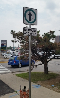 Reflective dismount and walk sign
