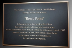 Bronze plaque with raised text and border Ben