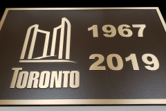 Bronze-plaque-with-raised-text-and-border-for-restored-bridge-Toronto