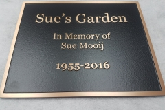 Raised text bronze plaque Sue's Garden