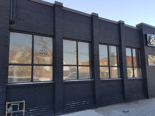 Full frosted windows reverse installed with cut out text